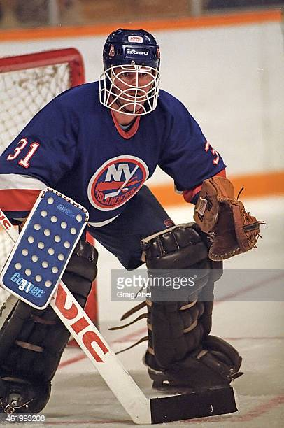 Billy Smith of the New York Islanders prepares for a shot against the Toronto Maple Leafs game action on November 6 1985 at Maple Leaf Gardens in...
