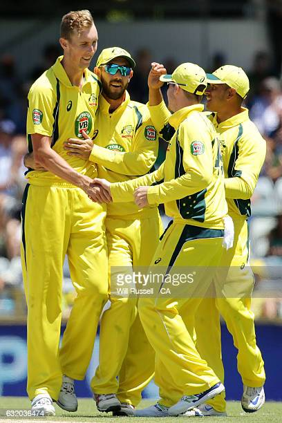 Billy Stanlake of Australia celebrates with Glenn Maxwell of Australia after taking the wicket of Shoaib Malik of Pakistan during game three of the...