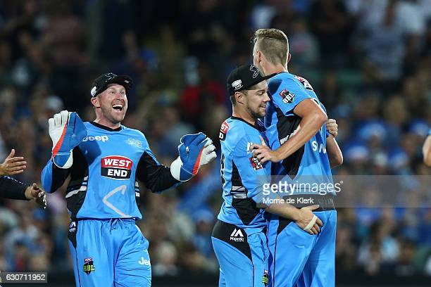 Billy Stanlake of the Adelaide Strikers is congratulated by teammates after getting the wicket of Brad Haddin of the Sydney Sixers during the Big...