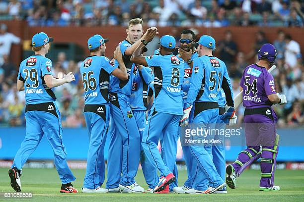 Billy Stanlake of the Adelaide Strikers is congratulated by teammates after getting the wicket of Dan Christian of the Hobart Hurricanes during the...