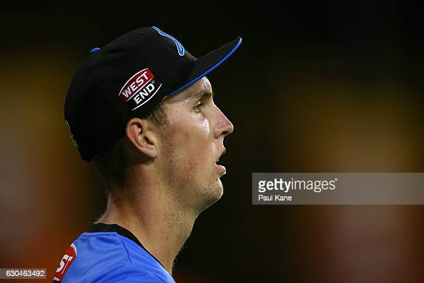 Billy Stanlake of the Strikers looks on while fielding during the Big Bash League between the Perth Scorchers and Adelaide Strikers at WACA on...
