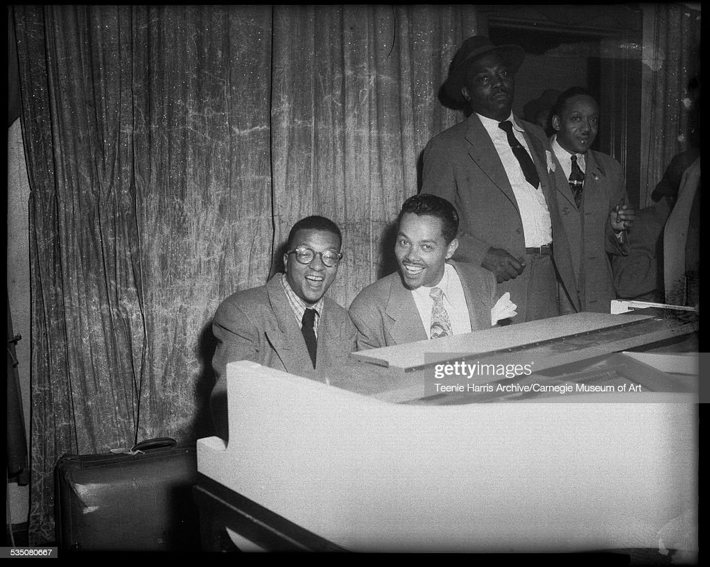 Billy Strayhorn and Billy Eckstine seated at piano with two men behind them, Pittsburgh, Pennsylvania, 1958.