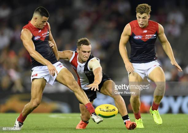 Billy Stretch of the Demons and Luke Dunstan of the Saints compete for the ball during the round one AFL match between the St Kilda Saints and the...
