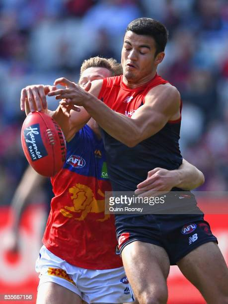 Billy Stretch of the Demons marks infront of Ryan Lester of the Lions during the round 22 AFL match between the Melbourne Demons and the Brisbane...