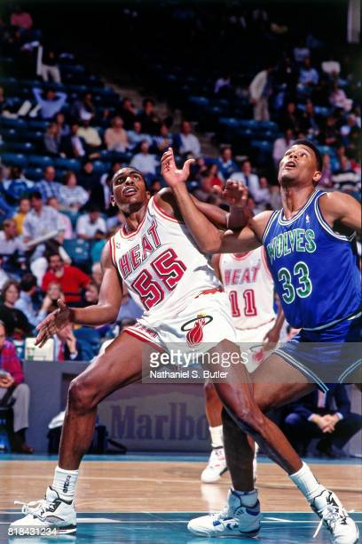 Billy Thompson of the Miami Heat boxes out against the Minnesota Timberwolves at the Miami Arena in Miami Florida circa 1991 NOTE TO USER User...