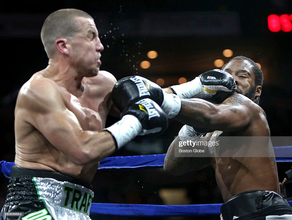 Billy Traft, of Dorchester, Mass., left, lands a left during his fight against Joe Powers, of Groton, Conn., during Night At The Fights at TD Garden, Jan. 26, 2013.