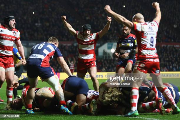 Billy Twelvetrees nd Willi Heinz of Gloucester lead the celebrations as Lewis Ludlow scores a try during the Aviva Premiership match between Bristol...