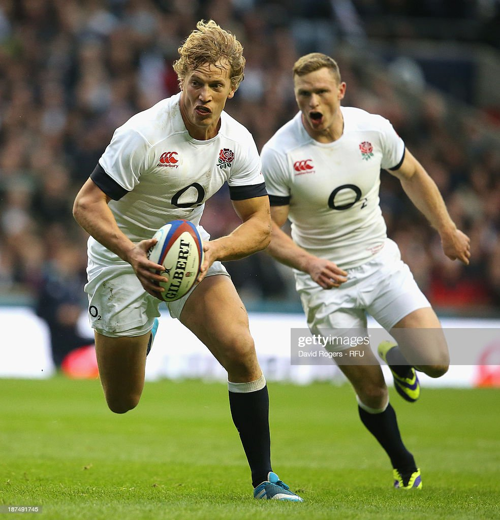 <a gi-track='captionPersonalityLinkClicked' href=/galleries/search?phrase=Billy+Twelvetrees&family=editorial&specificpeople=6175351 ng-click='$event.stopPropagation()'>Billy Twelvetrees</a> of England breaks clear to score a try during the QBE International match between England and Argentina at Twickenham Stadium on November 9, 2013 in London, England.