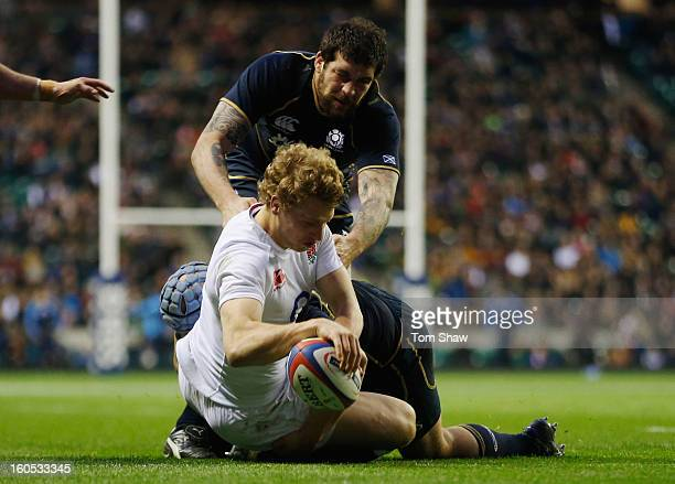 Billy Twelvetrees of England goes over to score his try during the RBS Six Nations match between England and Scotland at Twickenham Stadium on...