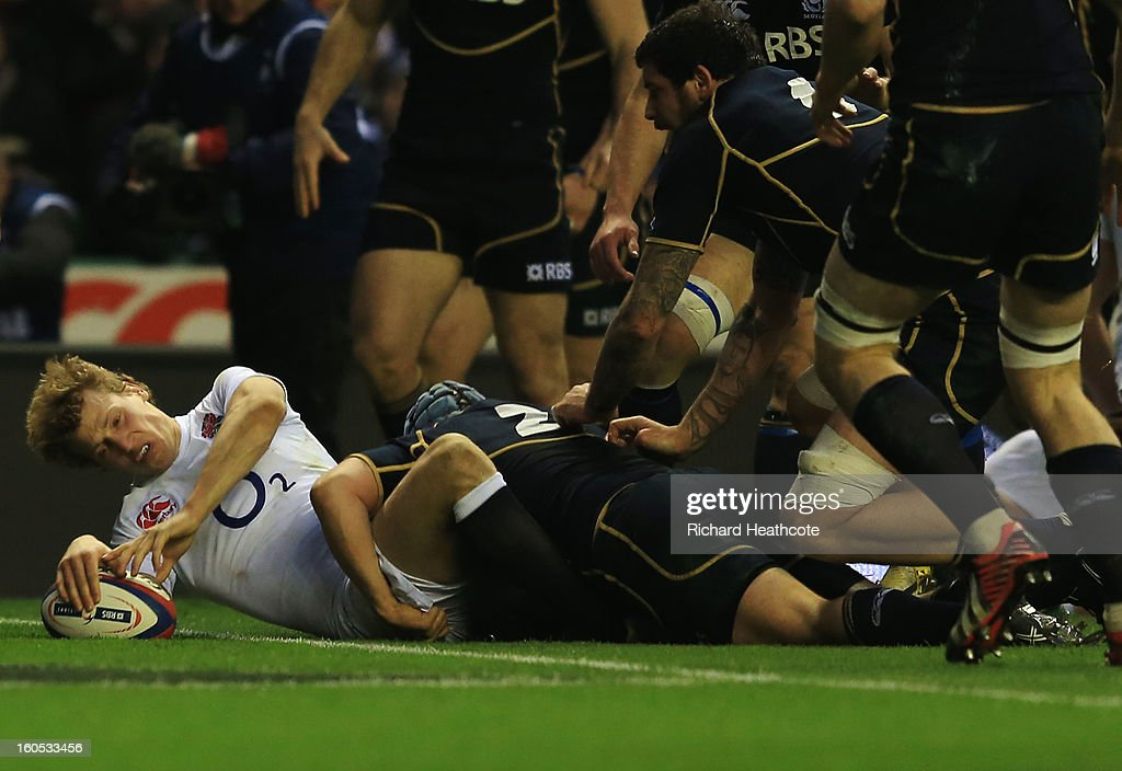 <a gi-track='captionPersonalityLinkClicked' href=/galleries/search?phrase=Billy+Twelvetrees&family=editorial&specificpeople=6175351 ng-click='$event.stopPropagation()'>Billy Twelvetrees</a> of England goes over to score his try during the RBS Six Nations match between England and Scotland at Twickenham Stadium on February 2, 2013 in London, England.