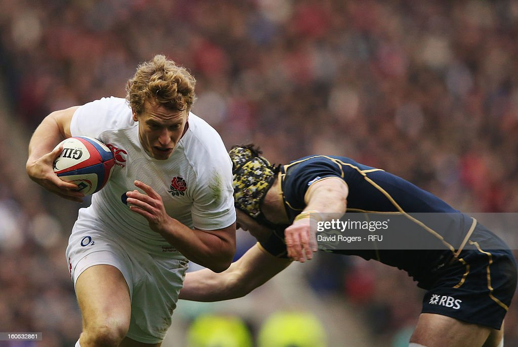Billy Twelvetrees of England is tackled by Kelly Brown of Scotland during the RBS Six Nations match between England and Scotland at Twickenham Stadium on February 2, 2013 in London, England.