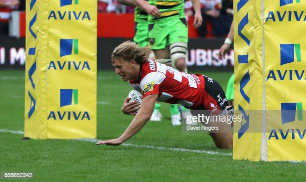 Billy Twelvetrees of Gloucester dives to score their fourth try during the Aviva Premiership match between Gloucester Rugby and Northampton Saints at...