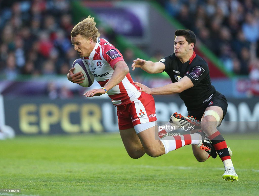 Billy Twelvetrees of Gloucester moves away from Sam Hidalgo-Clyne to score a try during the European Rugby Challenge Cup Final match between Edinburgh and Gloucester at Twickenham Stoop on May 1, 2015 in London, England.