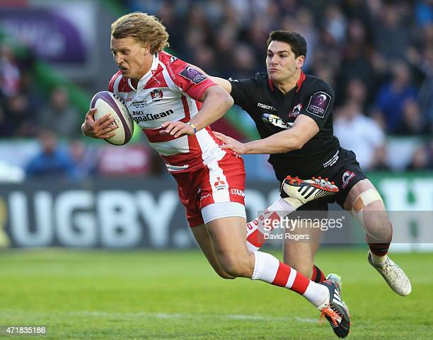 Billy Twelvetrees of Gloucester moves away from Sam HidalgoClyne to score a try during the European Rugby Challenge Cup Final match between Edinburgh...