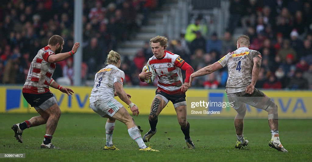 <a gi-track='captionPersonalityLinkClicked' href=/galleries/search?phrase=Billy+Twelvetrees&family=editorial&specificpeople=6175351 ng-click='$event.stopPropagation()'>Billy Twelvetrees</a> of Gloucester Rugby takes on Matt Hopper and George Merrick of Harlequins during the Aviva Premiership match between Gloucester Rugby and Harlequins at Kingsholm Stadium on February 13, in Gloucester, England.