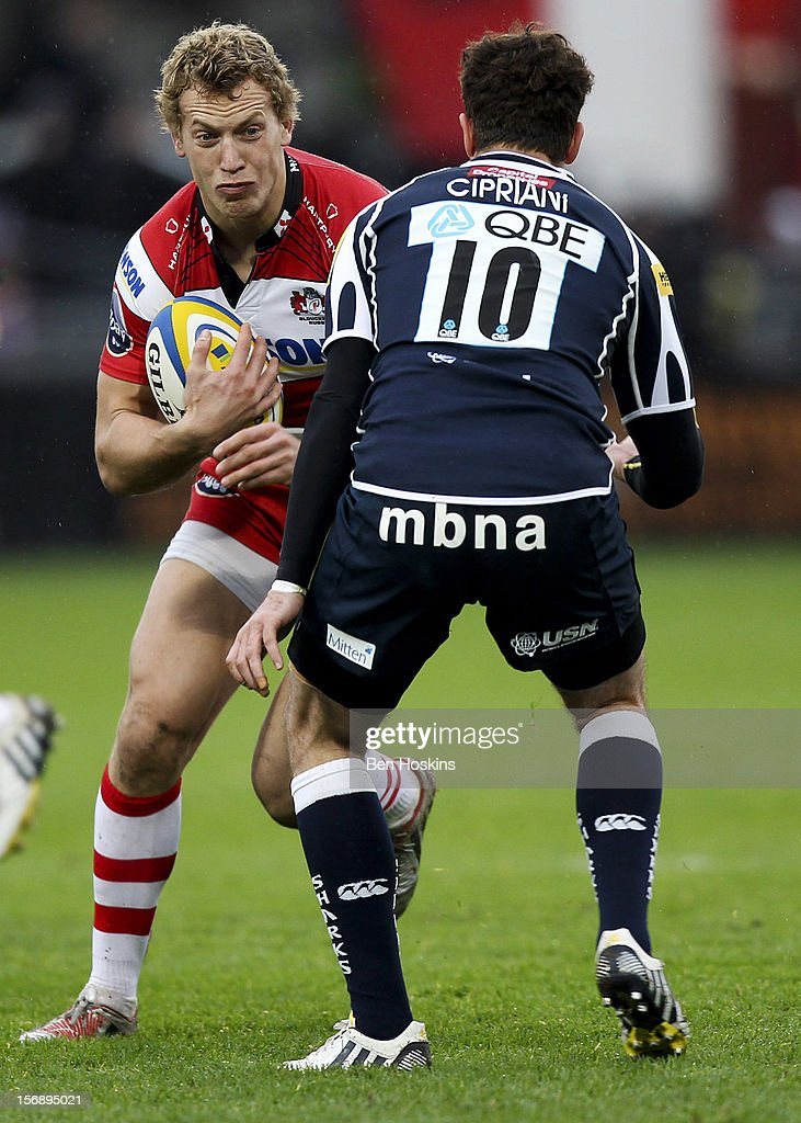 Billy Twelvetrees of Gloucester runs at Danny Cipriani of Sale during the Aviva Premiership match between Gloucester and Sale Sharks at the Kingsholm Stadium on November 24, 2012 in Gloucester, England.