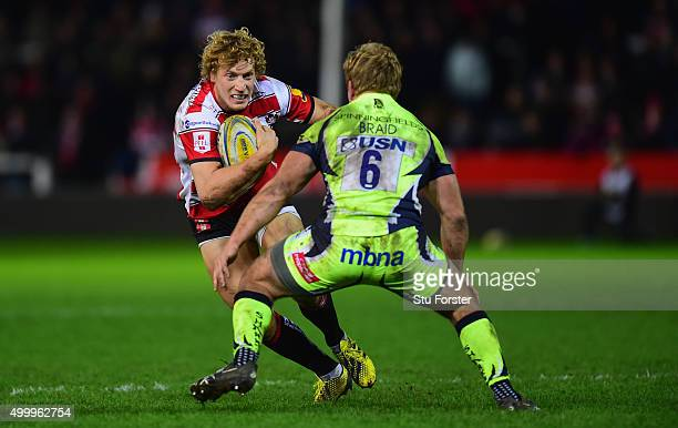 Billy Twelvetrees of Gloucester runs at the Sale forward Dan Braid during the Aviva Premiership match between Gloucester Rugby and Sale Sharks at...