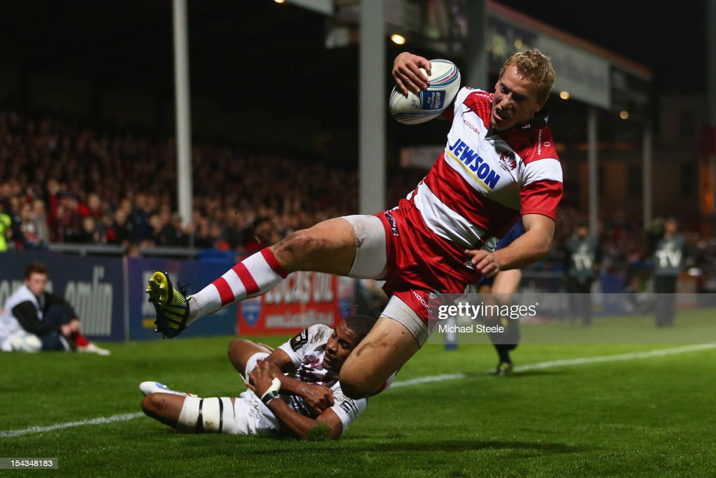 Billy Twelvetrees of Gloucester scores his sides second try as Darly Domvo of Bordeaux-Begles fails to tackle during the Amlin Challenge Cup match between Gloucester and Bordeaux-Begles at Kingsholm Stadium on October 18, 2012 in Gloucester, England.