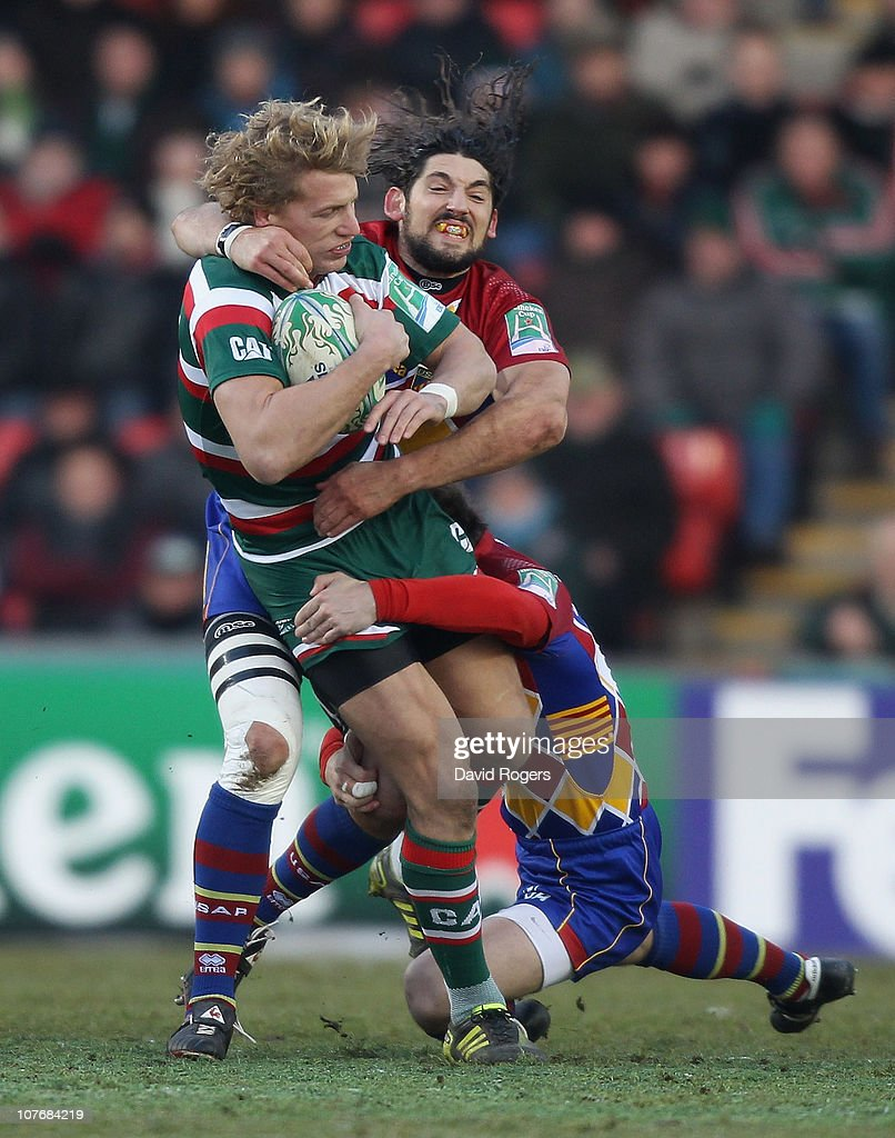 Billy Twelvetrees of Leicester is tackled Jean Pierre Perez during the Heineken Cup pool 5 match between Leicester Tigers and Perpignan at Welford...