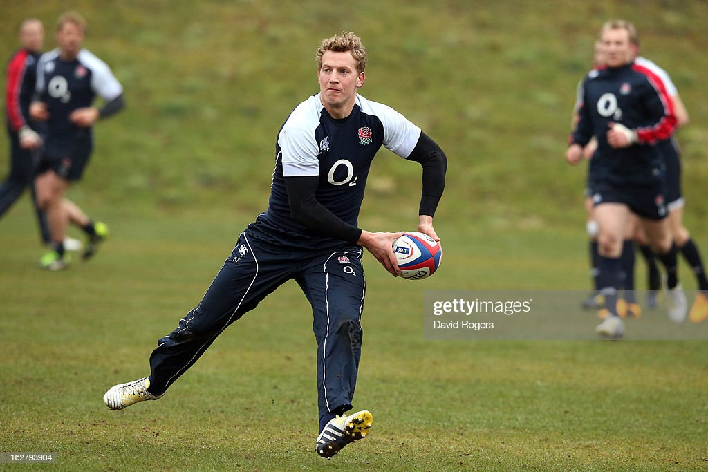 Billy Twelvetrees passes the ball during the England training session held at Pennyhill Park on February 26, 2013 in Bagshot, England.