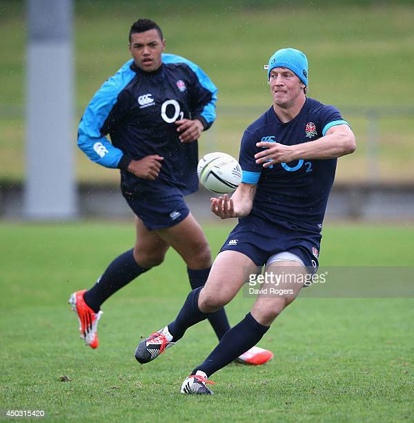Billy Twelvetrees passes the ball watched by Luther Burrell during the England training session held at the Onewa Oval on June 9 2014 in Auckland New...