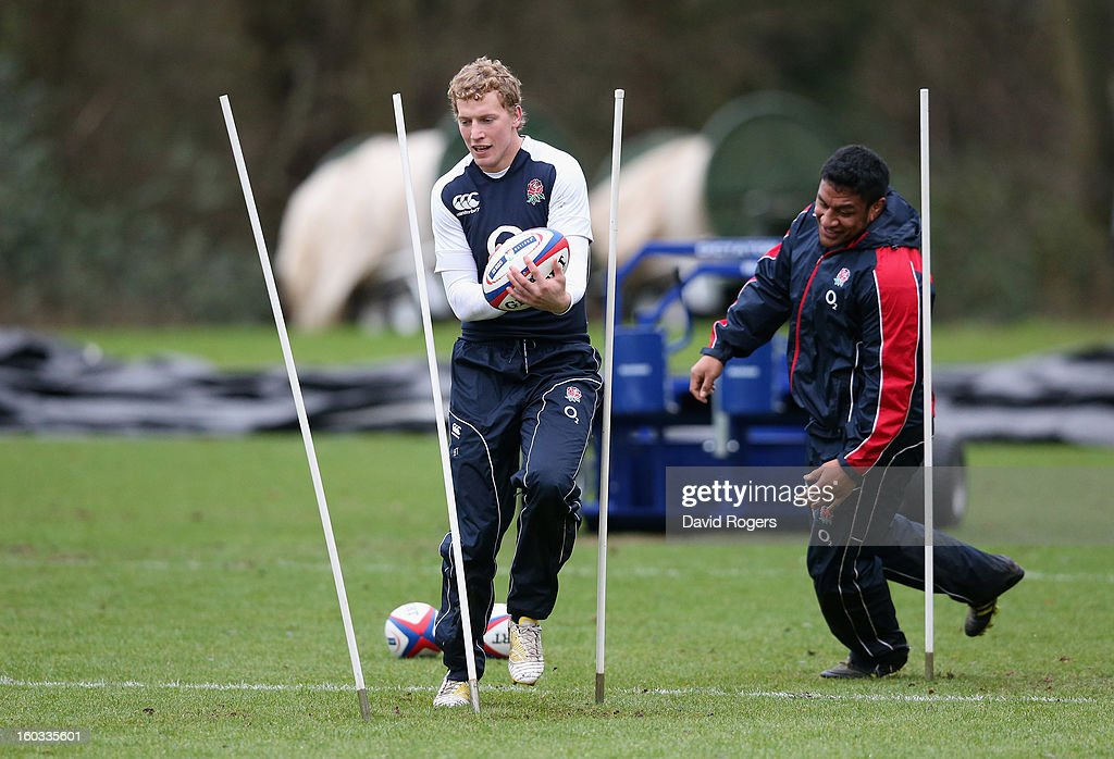 Billy Twelvetrees runs between the slalom poles during the England training session at Pennyhill Park on January 29, 2013 in Bagshot, England.