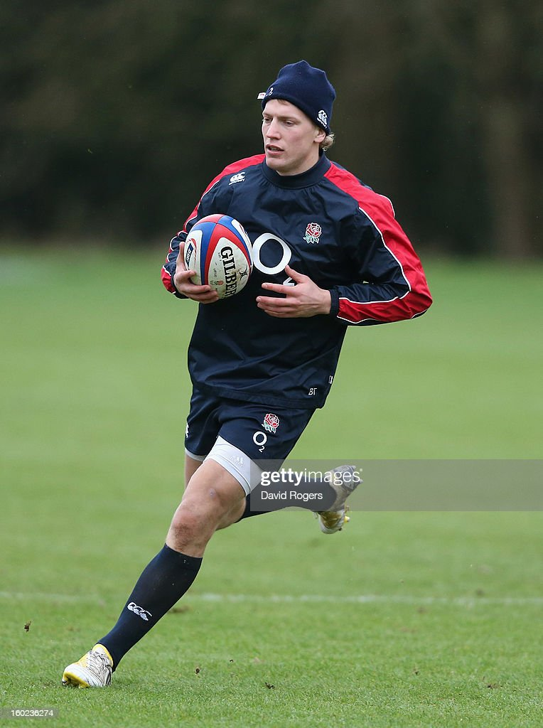 <a gi-track='captionPersonalityLinkClicked' href=/galleries/search?phrase=Billy+Twelvetrees&family=editorial&specificpeople=6175351 ng-click='$event.stopPropagation()'>Billy Twelvetrees</a> runs with the ball during the England training session held at Pennyhill Park on January 28, 2013 in Bagshot, England.
