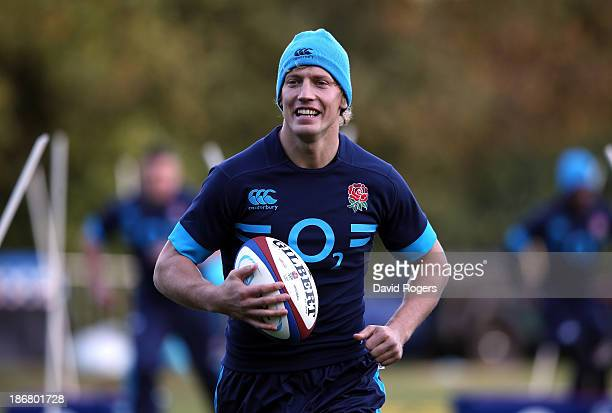 Billy Twelvetrees runs with the ball during the England training session held at Pennyhill Park on November 4 2013 in Bagshot England