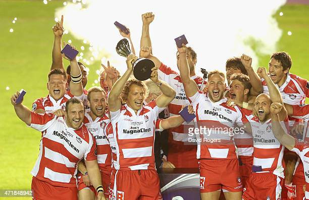 Billy Twelvetrees the Gloucester captain raises the trophy after their victory during the European Rugby Challenge Cup Final match between Edinburgh...