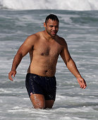 Billy Vunipola cools off in the ocean during the England recovery session held at Coogee Beach on June 20 2016 in Sydney Australia