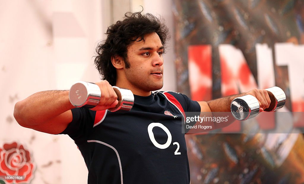 Billy Vunipola lifts weights during the England gym session held at Pennyhill Park on February 6, 2013 in Bagshot, England.