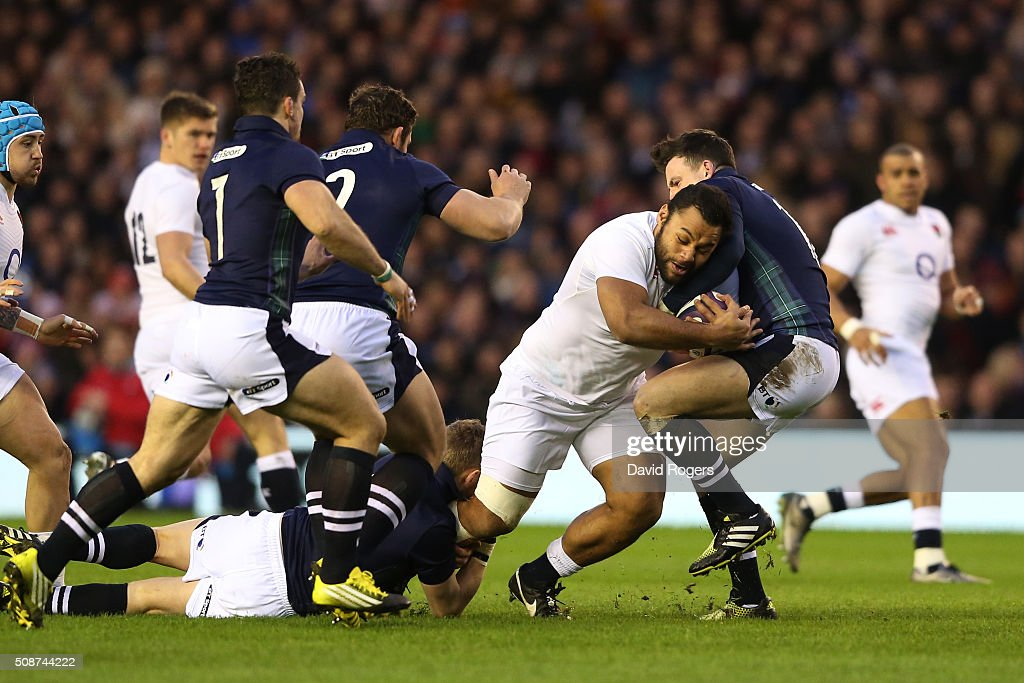 Billy Vunipola of England charges into Matt Scott of Scotland during the RBS Six Nations match between Scotland and England at Murrayfield Stadium on...