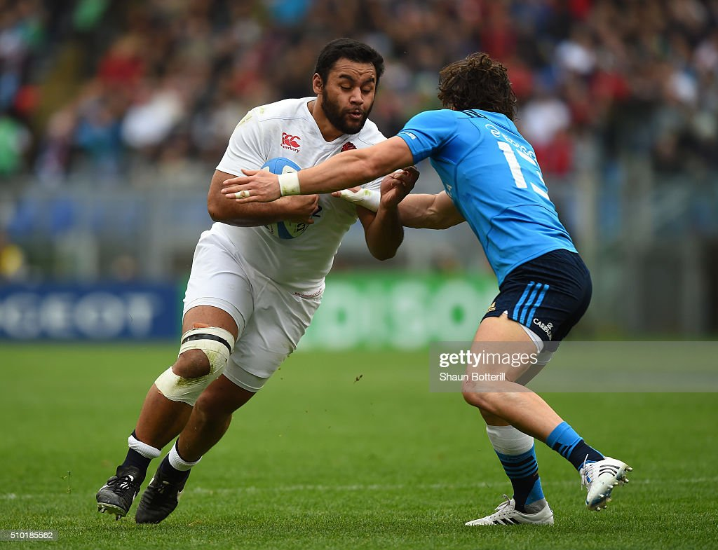 <a gi-track='captionPersonalityLinkClicked' href=/galleries/search?phrase=Billy+Vunipola&family=editorial&specificpeople=5771576 ng-click='$event.stopPropagation()'>Billy Vunipola</a> of England charges into Michele Campagnaro of Italy during the RBS Six Nations match between Italy and England at the Stadio Olimpico on February 14, 2016 in Rome, Italy.