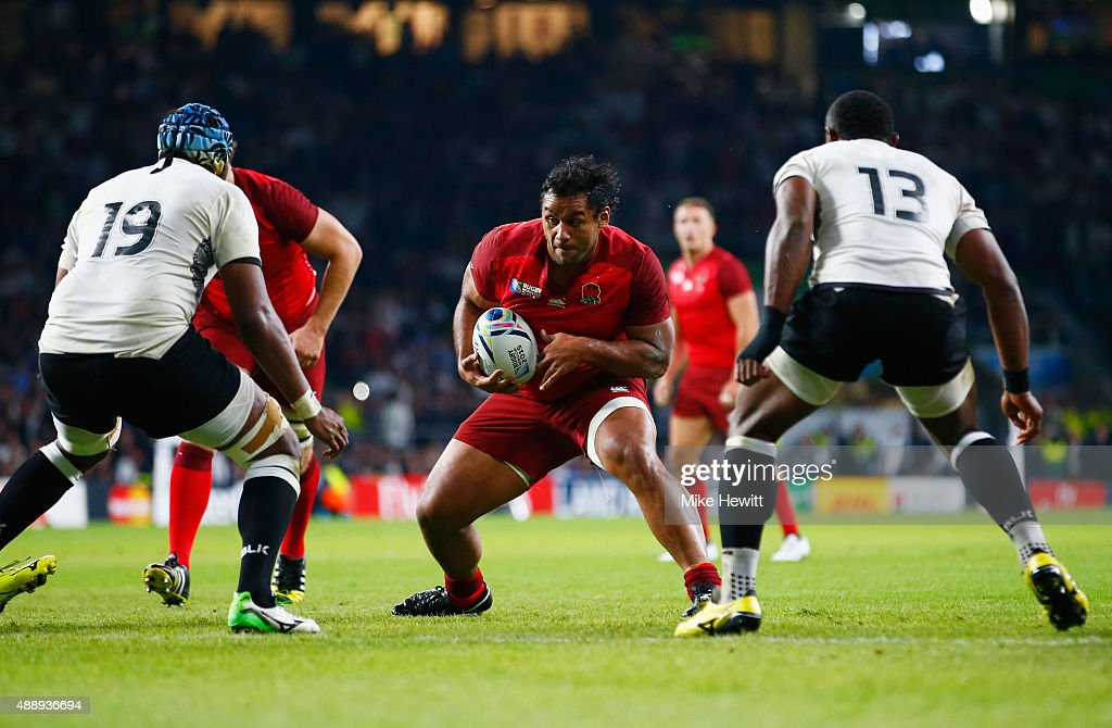 Billy Vunipola of England drives towards the try line during the 2015 Rugby World Cup Pool A match between England and Fiji at Twickenham Stadium on...
