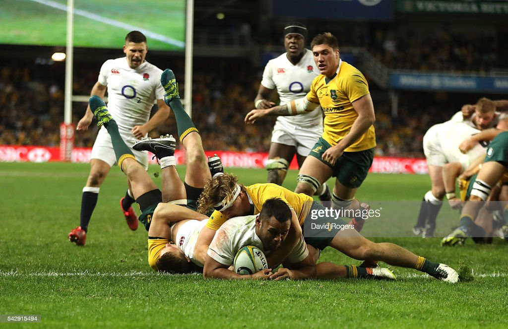 Billy Vunipola of England holds off Dane Haylett-Petty (L) and Michael Hooper to score their third try during the International Test match between the Australian Wallabies and England at Allianz Stadium on June 25, 2016 in Sydney, Australia.