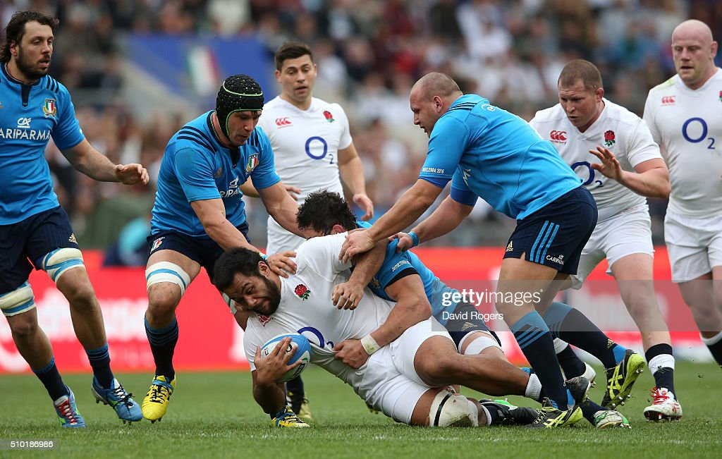 <a gi-track='captionPersonalityLinkClicked' href=/galleries/search?phrase=Billy+Vunipola&family=editorial&specificpeople=5771576 ng-click='$event.stopPropagation()'>Billy Vunipola</a> of England is hauled down by the Italy defence during the RBS Six Nations match between Italy and England at the Stadio Olimpico on February 14, 2016 in Rome, Italy.