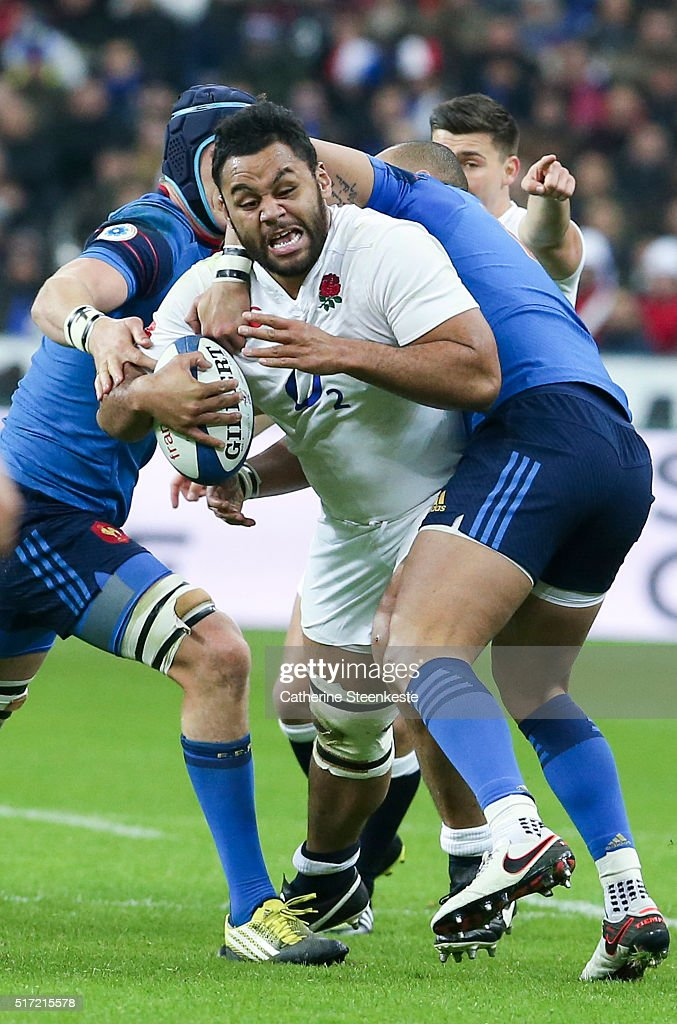 <a gi-track='captionPersonalityLinkClicked' href=/galleries/search?phrase=Billy+Vunipola&family=editorial&specificpeople=5771576 ng-click='$event.stopPropagation()'>Billy Vunipola</a> #8 of England is tackled by <a gi-track='captionPersonalityLinkClicked' href=/galleries/search?phrase=Bernard+Le+Roux&family=editorial&specificpeople=7397375 ng-click='$event.stopPropagation()'>Bernard Le Roux</a> #07 and Gael Fickou #13 of France during the RBS Six Nations game between France and England at Stade de France on March 19, 2016 in Saint Denis near Paris, France.