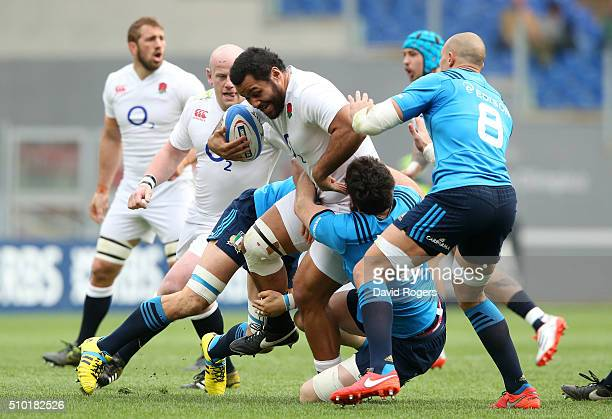 Billy Vunipola of England is tackled by Francesco Minto and George Biagi of Italy during the RBS Six Nations match between Italy and England at the...