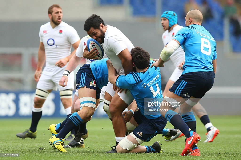 <a gi-track='captionPersonalityLinkClicked' href=/galleries/search?phrase=Billy+Vunipola&family=editorial&specificpeople=5771576 ng-click='$event.stopPropagation()'>Billy Vunipola</a> of England is tackled by Francesco Minto and George Biagi of Italy during the RBS Six Nations match between Italy and England at the Stadio Olimpico on February 14, 2016 in Rome, Italy.