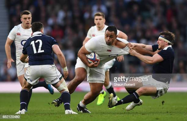 Billy Vunipola of England is tackled by Hamish Watson of Scotland during the RBS Six Nations match between England and Scotland at Twickenham Stadium...