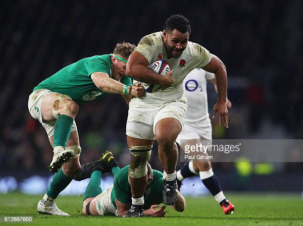 Billy Vunipola of England is tackled by Jamie Heaslip of Ireland during the RBS Six Nations match between England and Ireland at Twickenham Stadium...