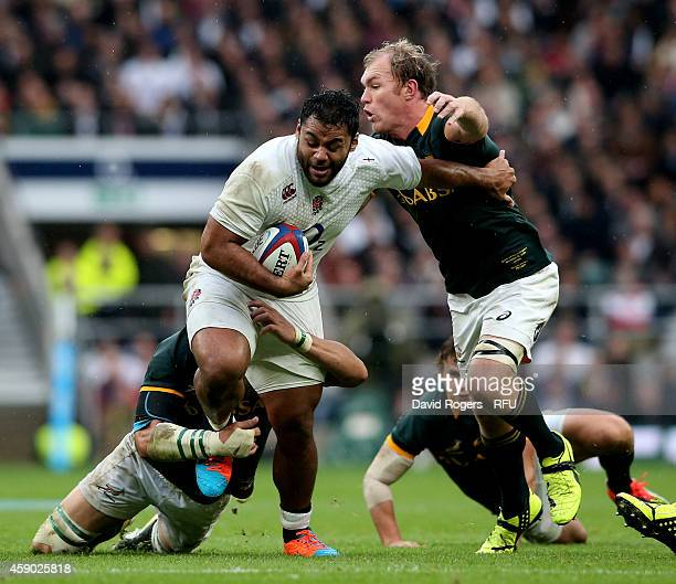 Billy Vunipola of England is tackled by Schalk Burger of South Africa during the QBE Intenational match between England and South Africa at...