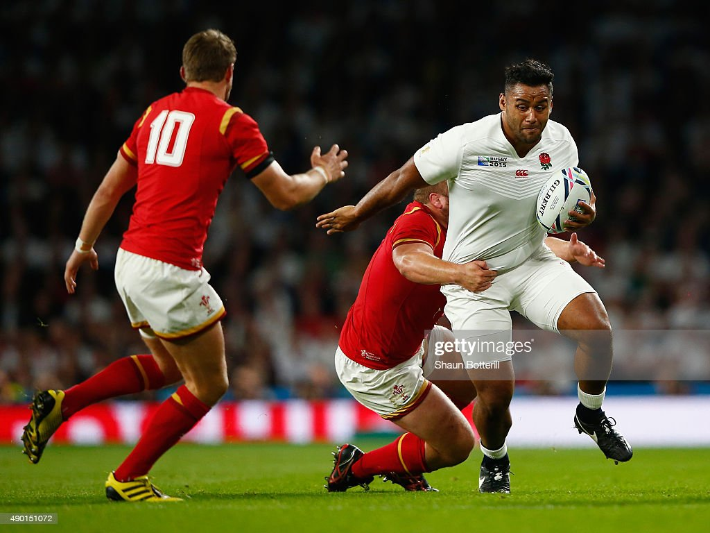 Billy Vunipola of England is tackled by Tom Francis of Wales during the 2015 Rugby World Cup Pool A match between England and Wales at Twickenham...
