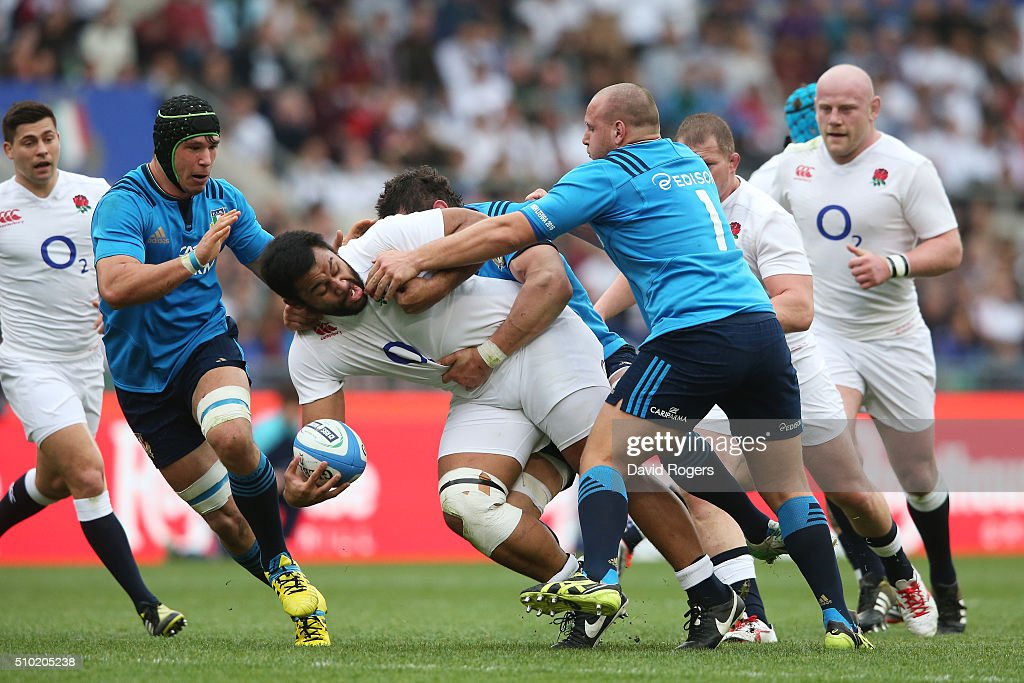 <a gi-track='captionPersonalityLinkClicked' href=/galleries/search?phrase=Billy+Vunipola&family=editorial&specificpeople=5771576 ng-click='$event.stopPropagation()'>Billy Vunipola</a> of England looks for support as he is wrapped up by the Italy defence during the RBS Six Nations match between Italy and England at the Stadio Olimpico on February 14, 2016 in Rome, Italy.