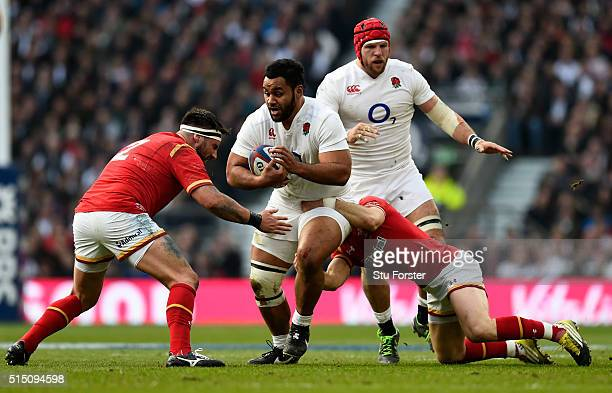 Billy Vunipola of England takes on Scott Baldwin and Gareth Davies of Wales during the RBS Six Nations match between England and Wales at Twickenham...