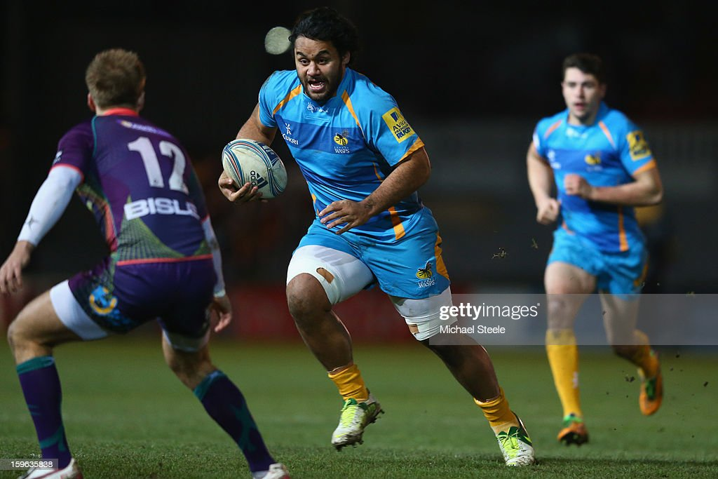 Billy Vunipola (C) of London Wasps runs at Ashley Smith (L) of Newport Gwent Dragons and during the Amlin Challenge Cup Pool Three match between Newport Gwent Dragons and London Wasps at Rodney Parade on January 17, 2013 in Newport, Wales.