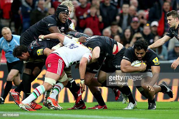 Billy Vunipola of Saracens crashes over to score his team's fifth and final try during the Aviva Premiership match between Saracens and Harlequins at...
