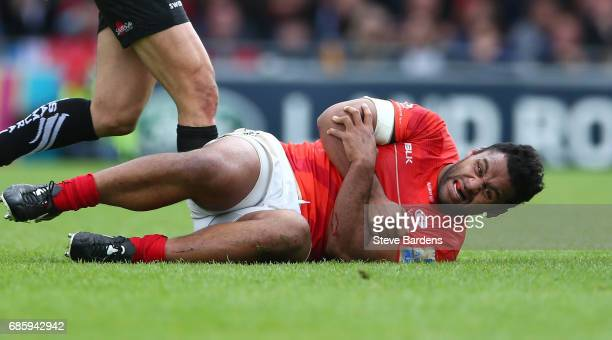 Billy Vunipola of Saracens goes down injured during the Aviva Premiership semi final match between Exeter Chiefs and Saracens at Sandy Park on May 20...