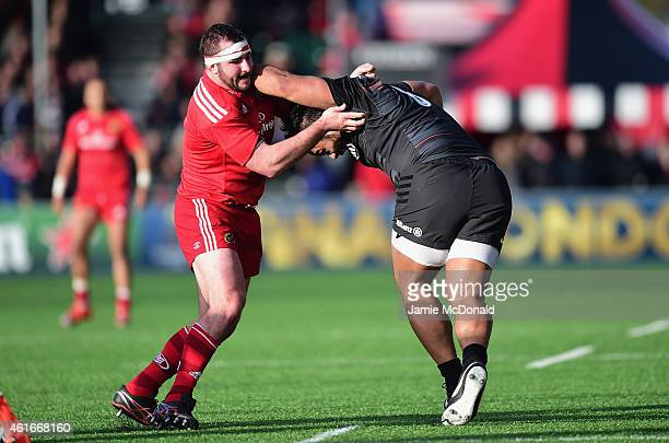 Billy Vunipola of Saracens holds off James Cronin of Munster during the European Rugby Champions Cup match between Saracens and Munster Rugby at...