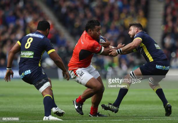 Billy Vunipola of Saracens is challenged by Damien Chouly of Clermont Auvergne during the European Rugby Champions Cup Final between ASM Clermont...